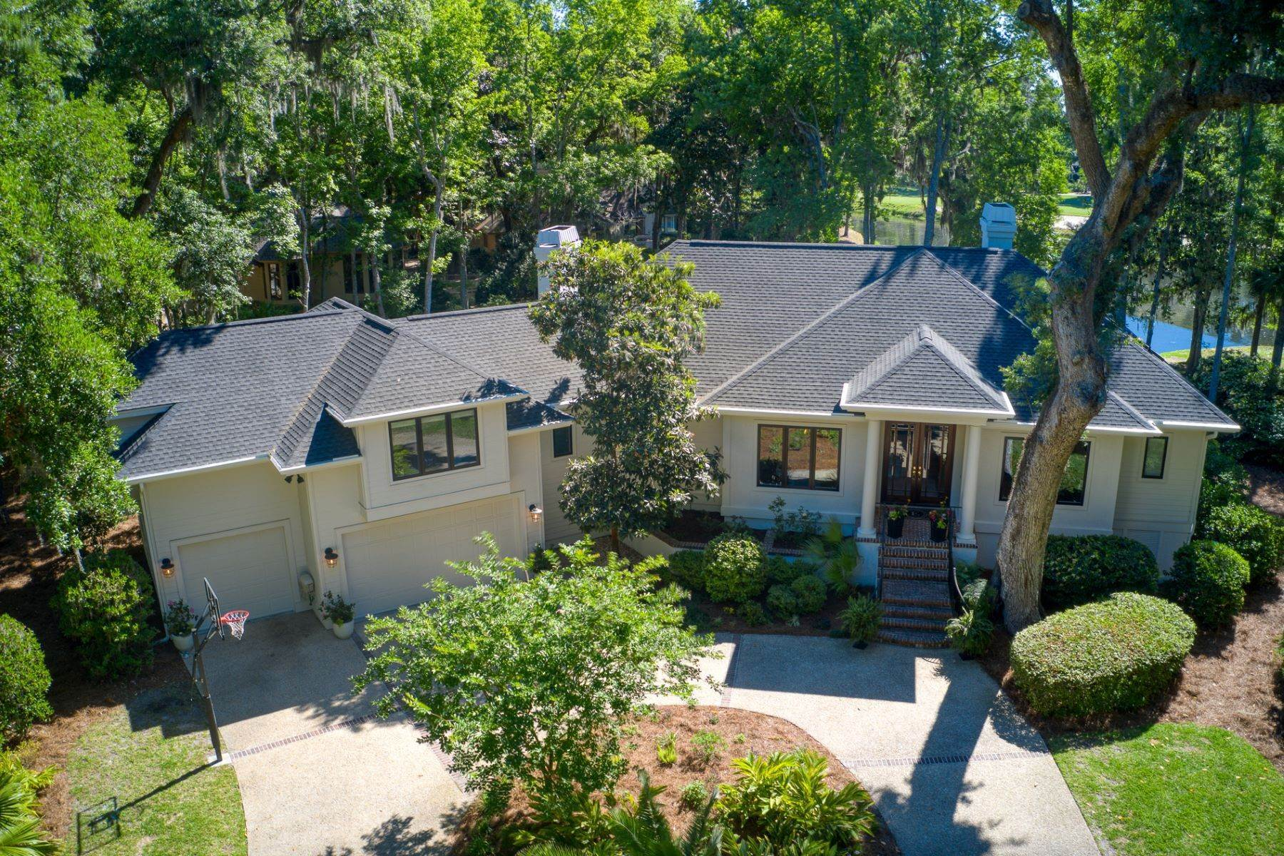 Single Family Homes for Sale at RECENTLY REMODELED HOME ON LAGOON OVERLOOKING GOLF COURSE IN LONG COVE CLUB 8 Chelsea Court Hilton Head Island, South Carolina 29928 United States
